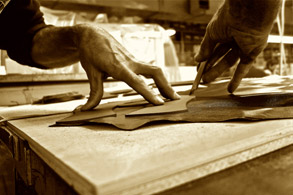 Man hand cutting leather